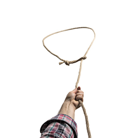 A lasso loop in the male hands , close-up on isolated white background.