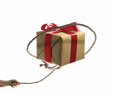 The gift falls into the loop of an abandoned lasso.