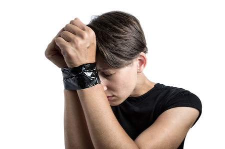 A girl with bound hands is subjected to violence. Image on white, isolated background. Stock Photo