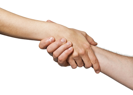 Two hands  united  in a handshake. Concept of  salvation, help, guardianship, protection, love, care etc. Image on white, isolated  background. 版權商用圖片