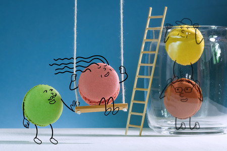 Funny macarons have a good time beside  jar for sweets. Hand-drawn colorful image of funny macarons.