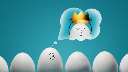 An egg is dreaming about golden crown on blue background. Concept of narcissism.