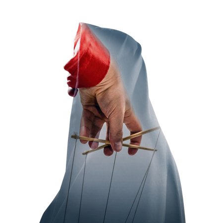 Concept of mind control. Silhouette of a woman in a cloak with marionette image. Double exposure. White isolated background. Stock Photo