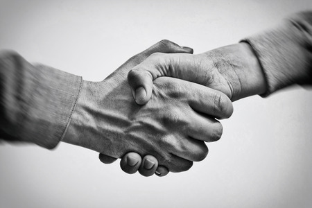 A firm handshake between two partners. Black and white image. Foto de archivo - 120315149