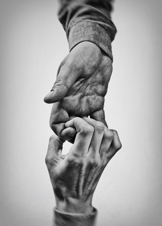 A firm handshake between two partners. Black and white image.