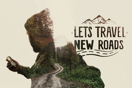 Double exposure landscape with bearded traveler, road and lettering. Metaphor of travel. Stockfoto