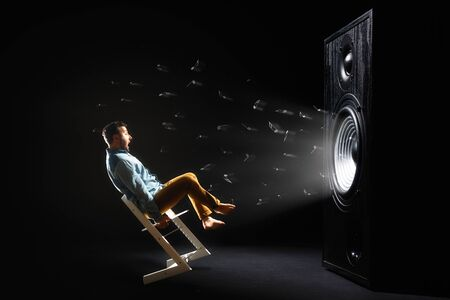 The sound wave set back an chair with screaming man. Stok Fotoğraf