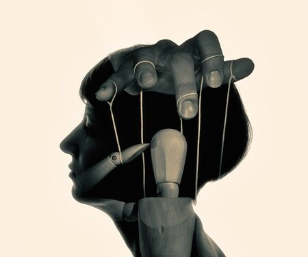 Marionette in woman head, black and white. Concept of mind control. Image Stok Fotoğraf