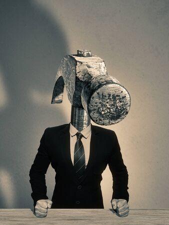 The man in a suit with a head in the form of a hammer. Metaphor of an angry boss.