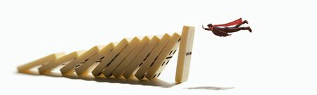 The man stops the falling dominoes. Concept of crisis management. Stok Fotoğraf - 130680201