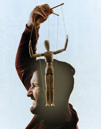 Man take out the puppet of his head. Get rid of dependencies. Stok Fotoğraf