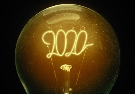 The concept of the new 2020 year. Filament lamp with numbers 2020. Cozy image. Hygge mood.