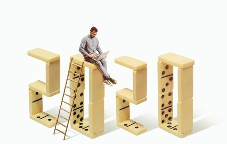 New 2020 year. Man with laptop is sitting on numerals 2020. Business concept. Stok Fotoğraf - 130680217