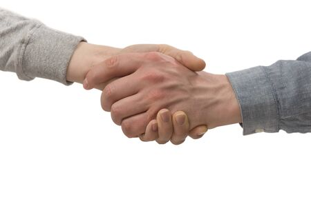 A firm handshake between two partners on isolated white background. Image.