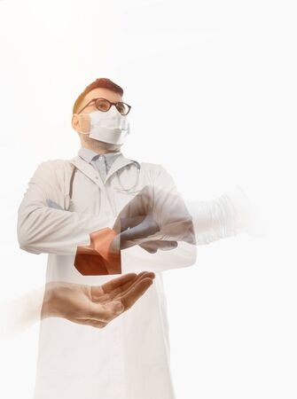 Double exposure image with doctor and helping hand with heart. Concept of salvation, donorship, helping hand. Reklamní fotografie