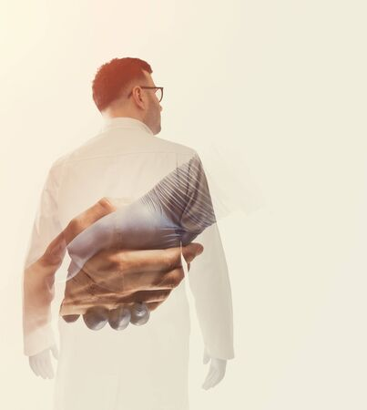 Double exposure image with doctor and helping hand. Concept of salvation, donorship, helping hand. Reklamní fotografie