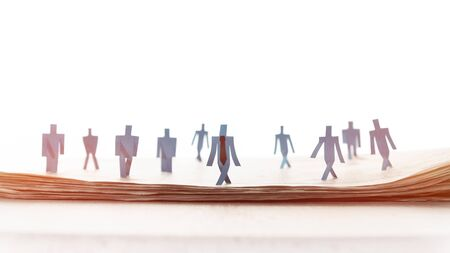Business recruitment or hiring photo concept. Looking for talent.  Figure of candidates are standing on open newspaper. Reklamní fotografie