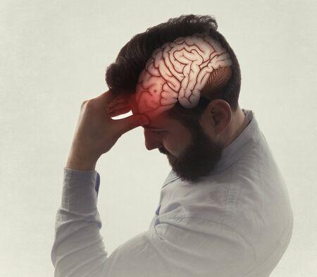 Concept of Head Pain. Sad man with headache, migraine, stress, PTSD etc. Image Reklamní fotografie