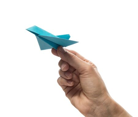 Blue paper plane in human palm. Concept of booking plane ticket, charters, tour. Isolated on white. Imagens