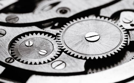 Clockwork gears wheels, close up view. Industry background. Black and white.