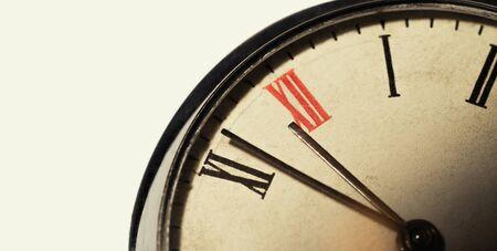 Photo of vintage pocket watch with roman numerals. Close-up Standard-Bild