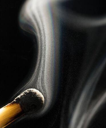 Smoke on a burnt match. Close-up. Macro photography.