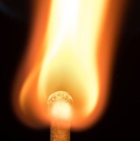 Flash of flame on a match. Close-up. Macro photography.