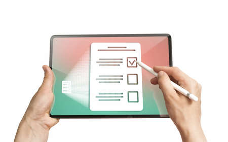 Woman selects the right answer in questionnaire on her digital tablet. Concept of online testing, questionnaires, voting. Isolated on white Banco de Imagens