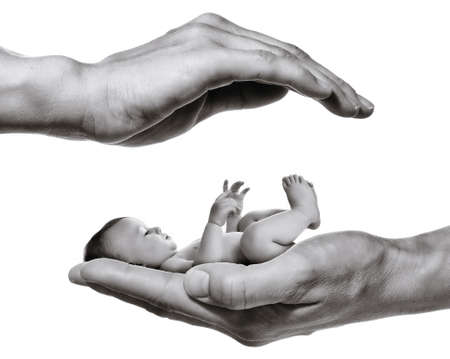 Concept of child care. Baby in mother palm on white isolated background.