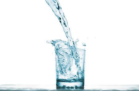 Water splash in transparent glass. Isolated on white Standard-Bild