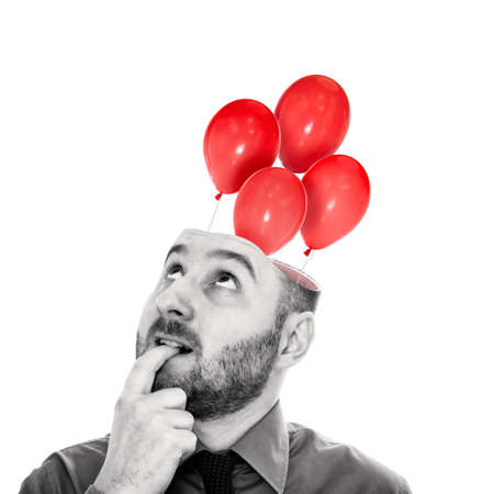 Red balloons fly out of the man's head. The concept of a new idea. Black and white.
