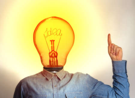 Concept of a new idea. A man with a light bulb instead of a head.