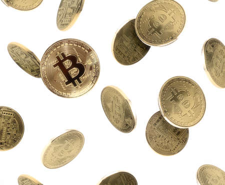 Falling bitcoin coins on white isolated background. Bitcoin background. Abstract. Reklamní fotografie