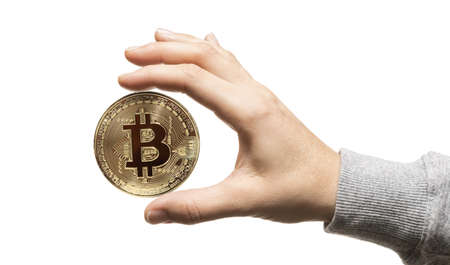 The woman hand with coin of bitcoin on white isolated background.