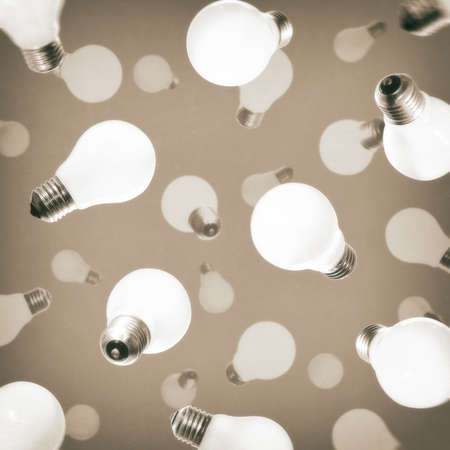 Abstract pattern with falling light bulbs. The concept of new ideas, creativity, revolutionary discoveries. Фото со стока