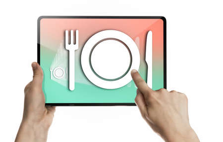 The woman clicks on the restaurant icon on her digital tablet. Concept of food delivery. Isolated on white.