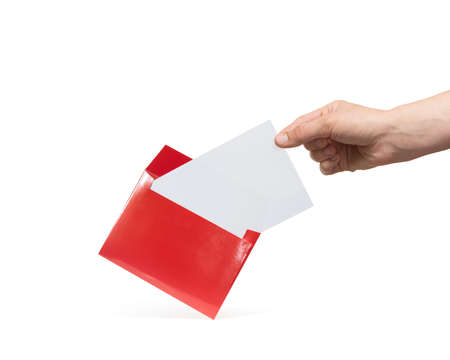 A hand takes a sheet of white paper from a red envelope. Mockup. Isolated on white.