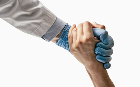 Doctor rescues a patient on white isolated background. Concept of rescues, treatment, helping hand. Standard-Bild