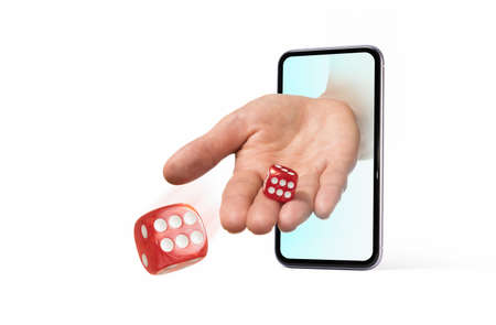 Hand throws dice from smartphone on white isolated background. Concept of online casino.