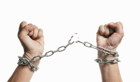 Man breaks the chains and gains freedom. The concept of gaining freedom. Stock Photo