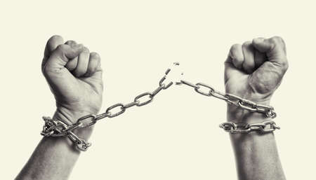 Man breaks the chains and gains freedom. The concept of gaining freedom. Black and white.