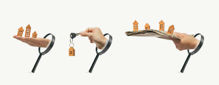 Set with three loupes and hands with paper houses. Concept of real estate search. Stock Photo