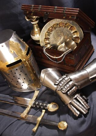 Still-life with an armour, the weapon and treasures Stock Photo - 4724498