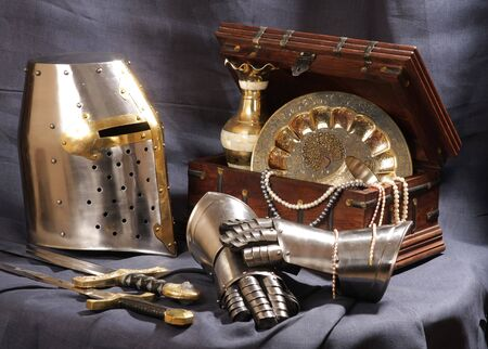 Still-life with an armour, the weapon and treasures Stock Photo - 4724599