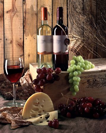 Two bottles of wine with grapes and cheese Stock Photo - 4724572