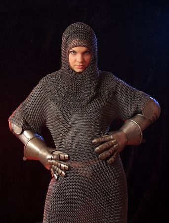 The girl in a medieval knightly armour photo