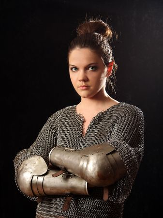 The girl in a medieval knightly armour Stock Photo