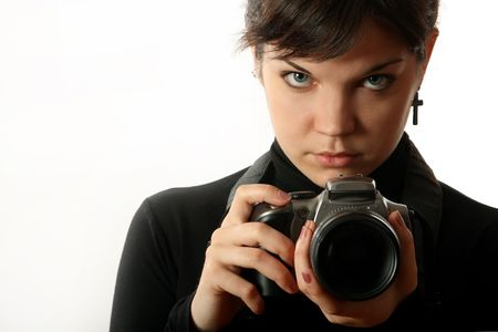 The beautiful girl with a camera on a white background Stock Photo