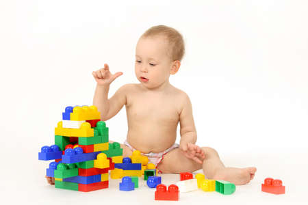 The small child plays the designer a white background Stock Photo - 4739026