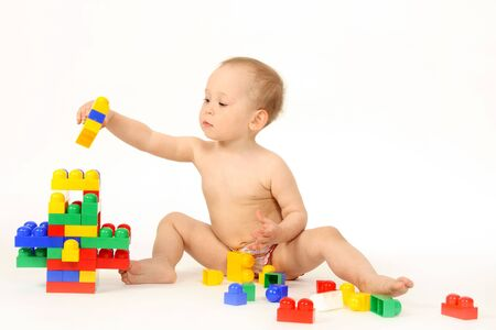 The small child plays the designer a white background Stock Photo - 4738946